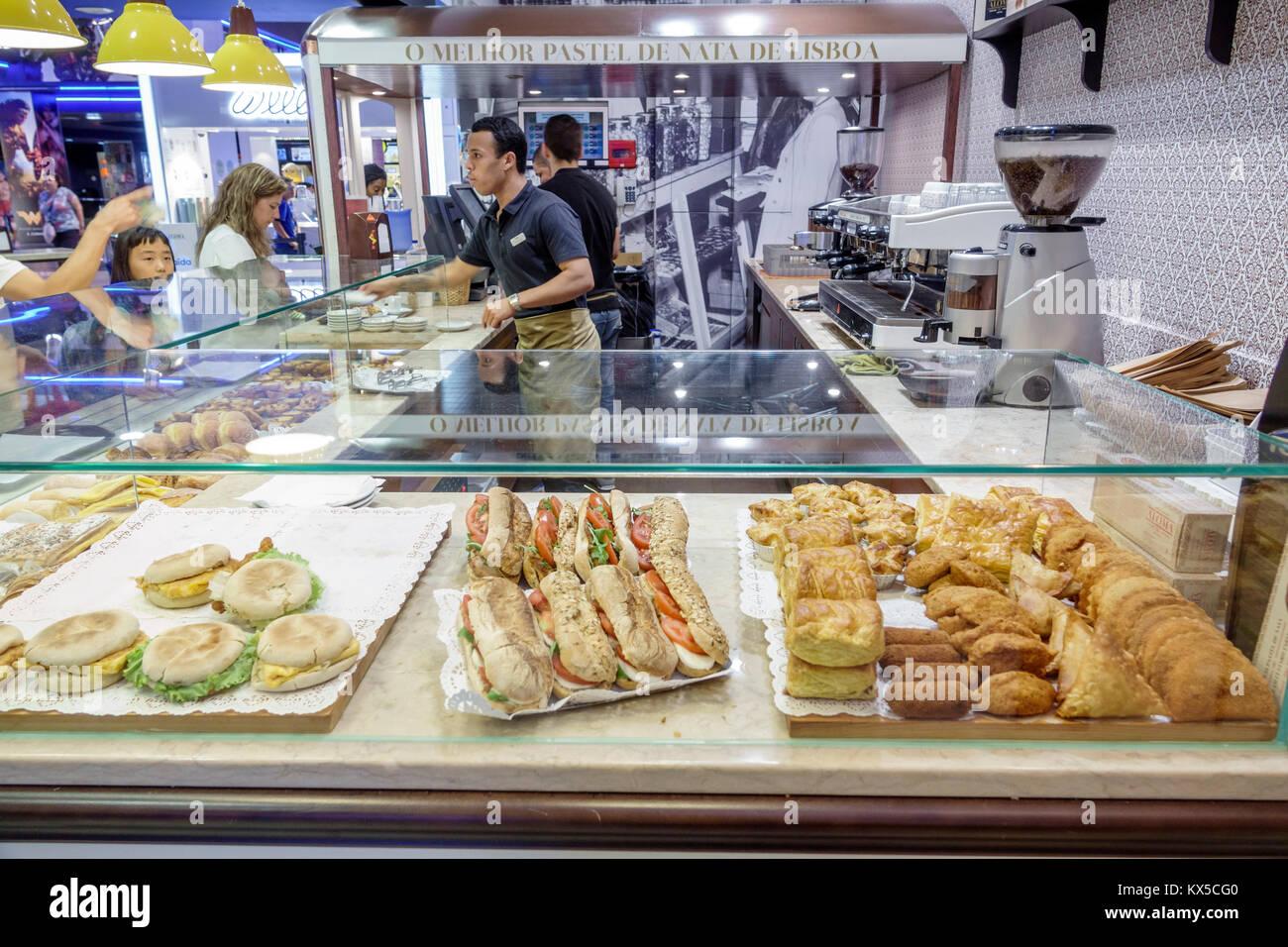 Lisbon Portugal Sao Sebastiao El Corte Ingles Megastore Department Store Cafeteria Food Court Vendor Bakery Restaurant Man Girl Woman Sandwich Portuguese