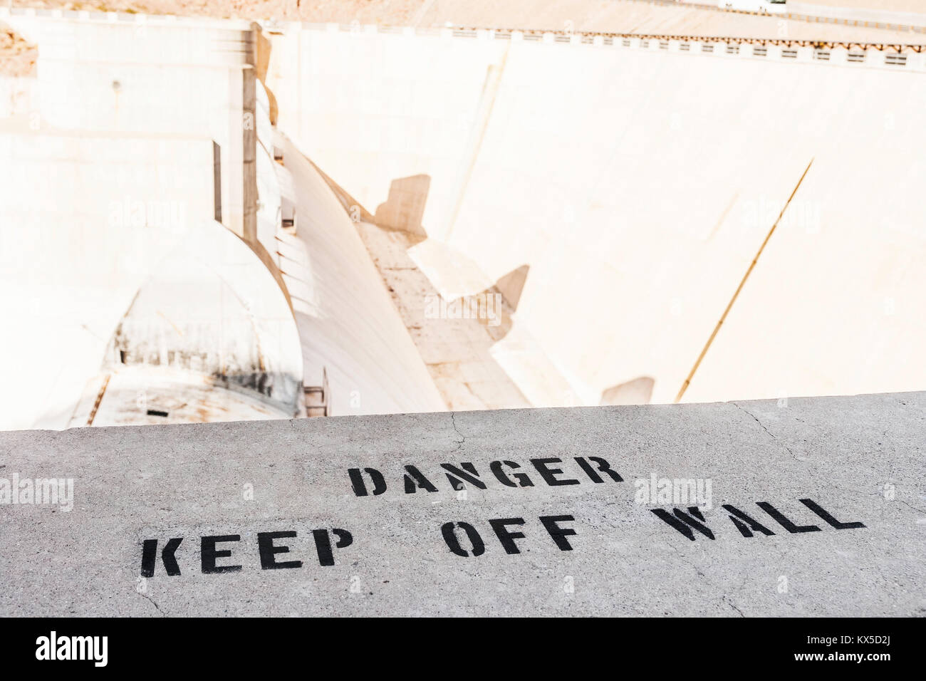 Warning information stencil on a wall at the Hoover dam, Nevada, usa. - Stock Image