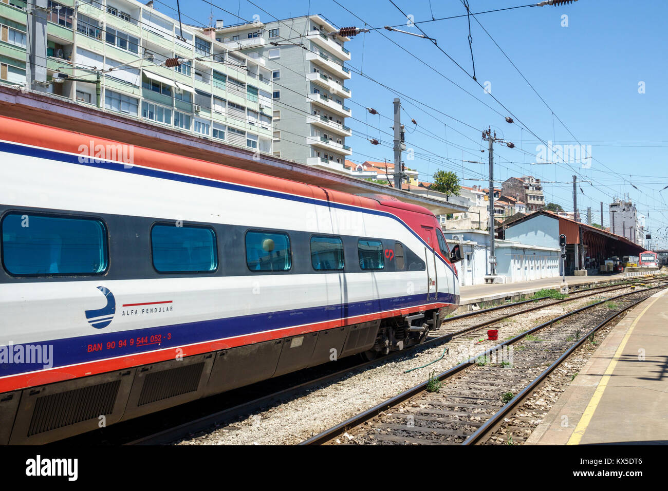 Lisbon Portugal Santa Apolonia Comboios de Portugal railway train track Alfa Pendular Pendolino high-speed tilting - Stock Image