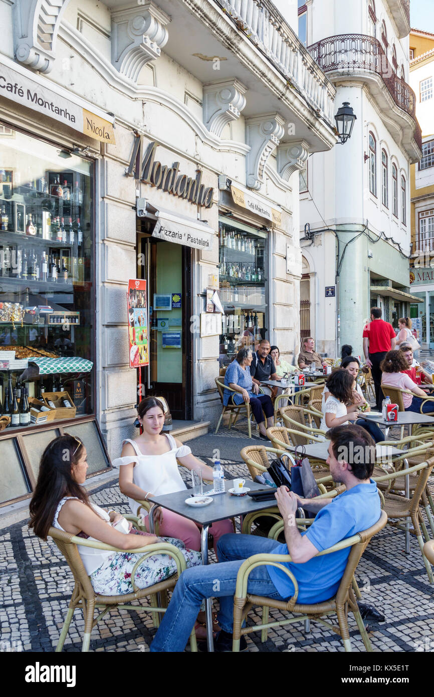Coimbra Portugal historic center Largo da Portagem main square Cafe Montanha restaurant alfresco outside dining - Stock Image