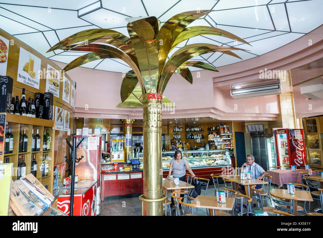 Coimbra Portugal historic center Largo da Portagem main square Cafe Montanha restaurant inside decor metal palm - Stock Image