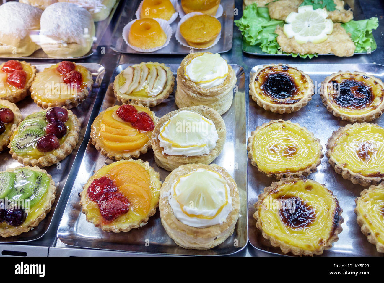 Coimbra Portugal historic center Largo da Portagem main square Cafe Montanha restaurant pastry shop bakery display - Stock Image