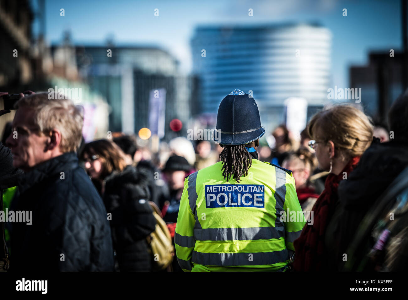 Metropolitan Police Officer on duty during a protest march in London - Stock Image