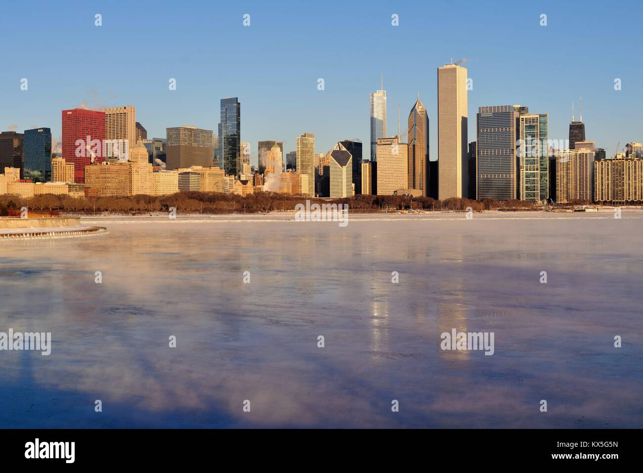Winds and bitter cold created vapor above the ice in Lake Michigan and exhausting from buildings. Chicago, Illinois, - Stock Image