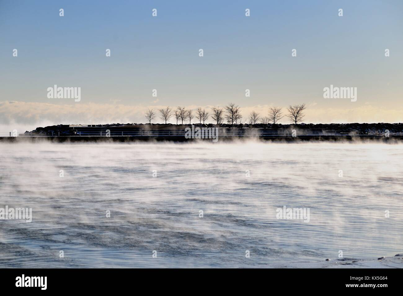Vapor rises from Ice forming on Lake Michigan waters in Chicago's 31st Street Harbor. Chicago, Illinois, USA. - Stock Image