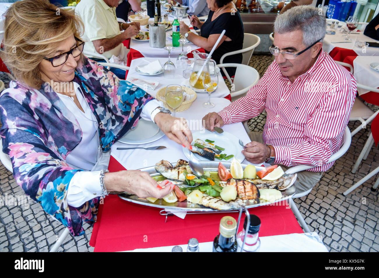 Lisbon Portugal Rossio historic center Restaurante Prazeres do Mar restaurant dining Marisqueira seafood plate tray - Stock Image