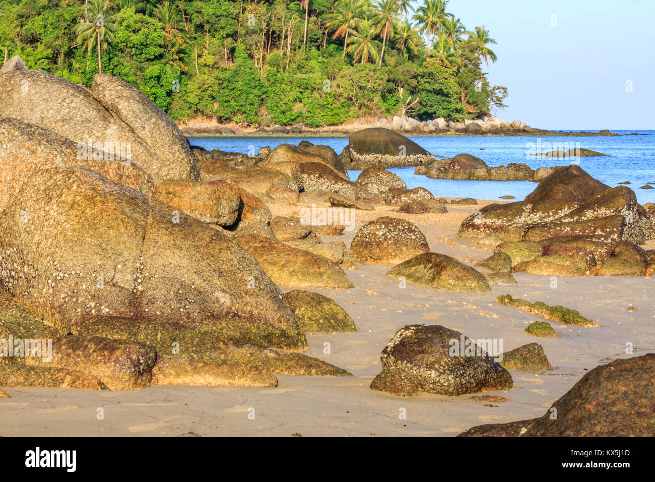 Rocks on tropical beach, Bang Tao, Phuket, Thailand - Stock Image