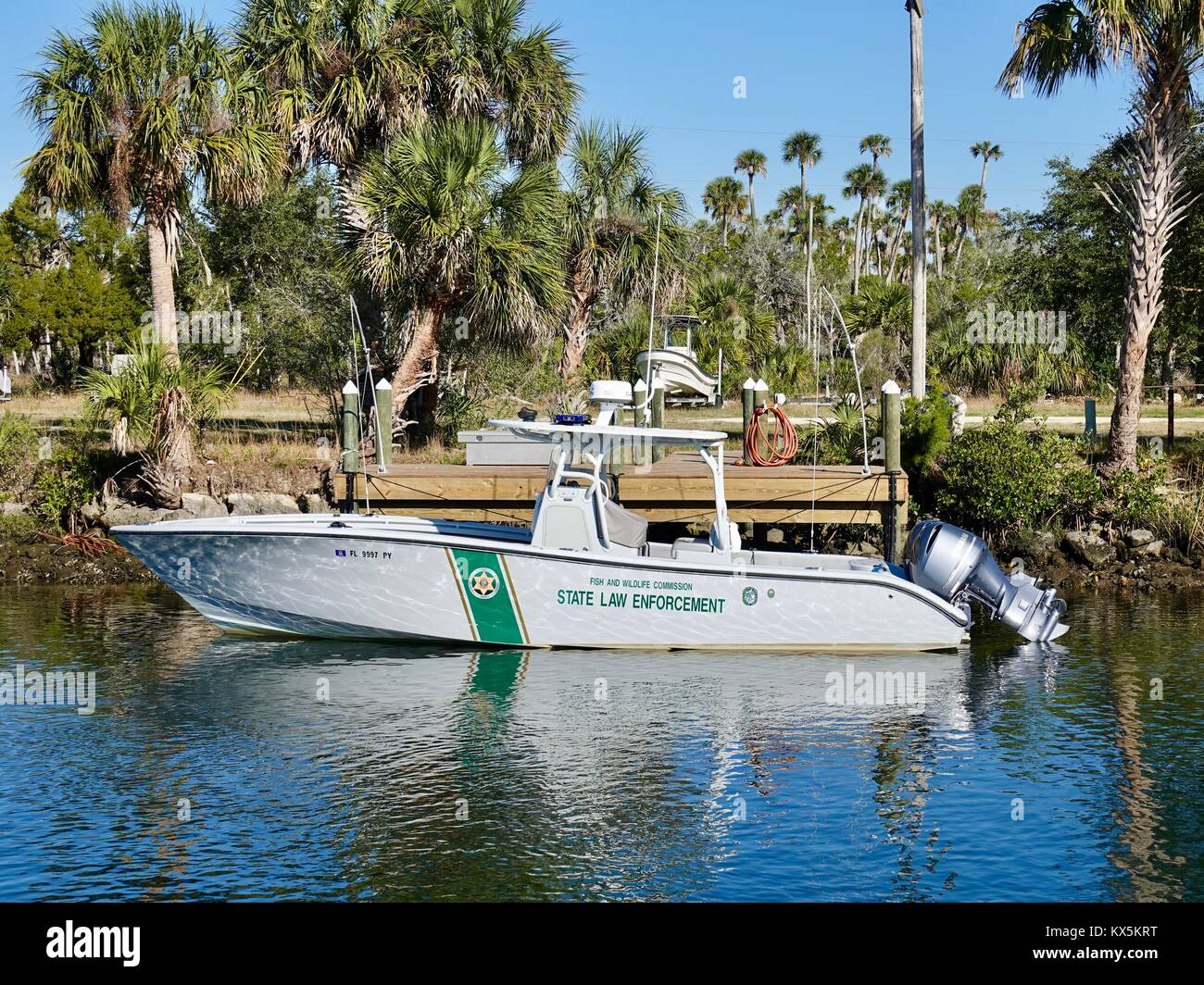 Florida Fish and Wildlife Commission State Law Enforcement boat tied to dock. Crystal River, Citrus County, Florida, Stock Photo