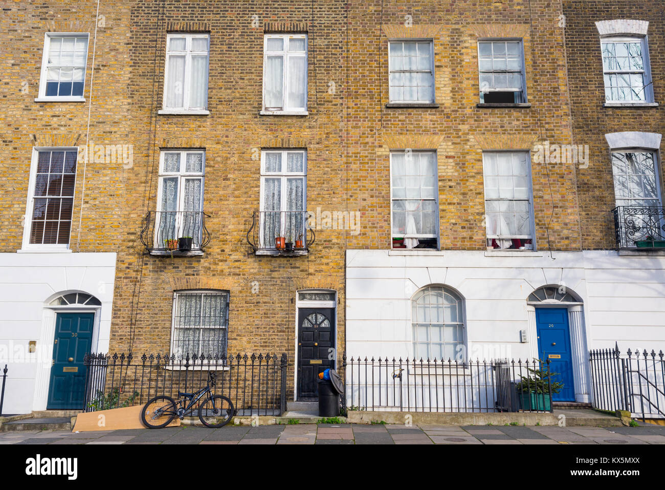 Angel, London, UK - January 2018: Facade of Edwardian Victorian restored residential houses in yellow bricks with - Stock Image
