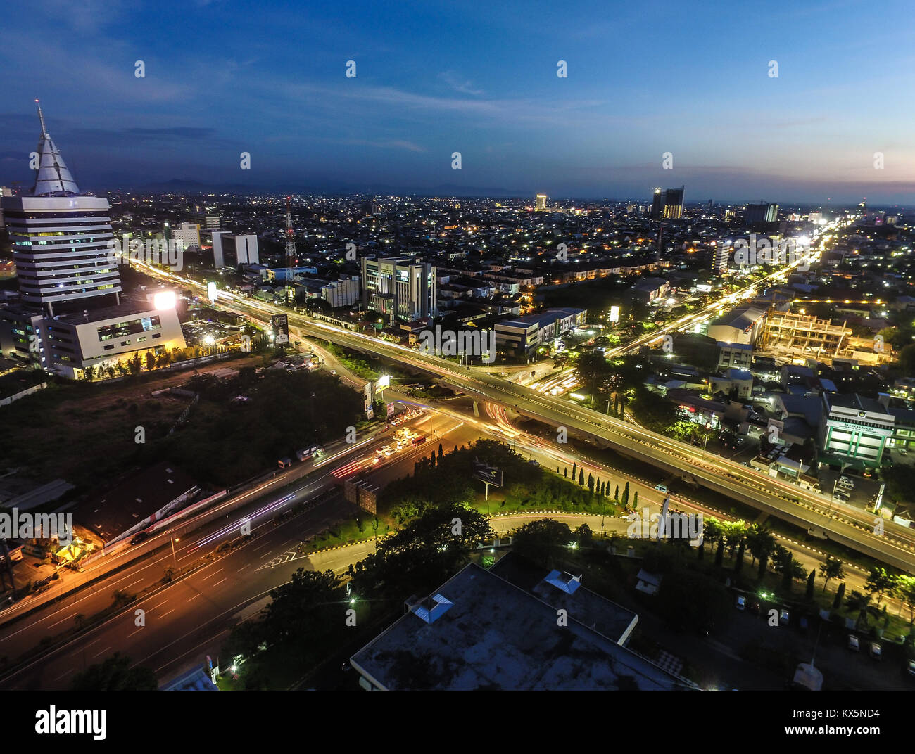 The city of Makassar just a moment after the sunset. - Stock Image