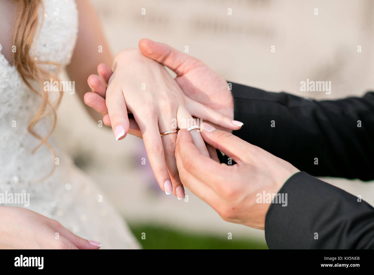 wedding rings and hands of bride and groom. young wedding couple at ...