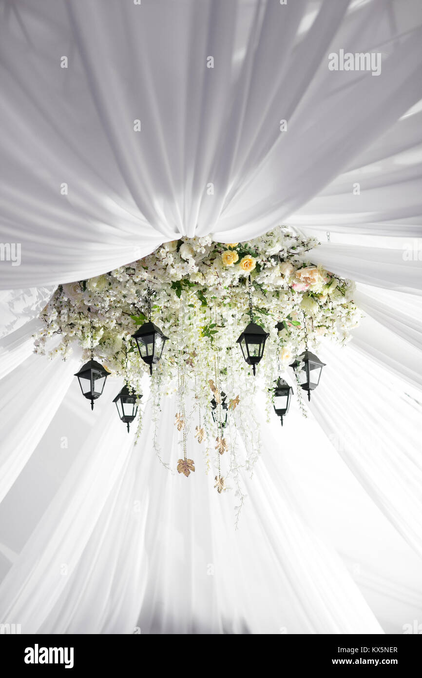 Chandelier made of roses and white flowers hangs under the light chandelier made of roses and white flowers hangs under the light tent decorative lights arubaitofo Image collections
