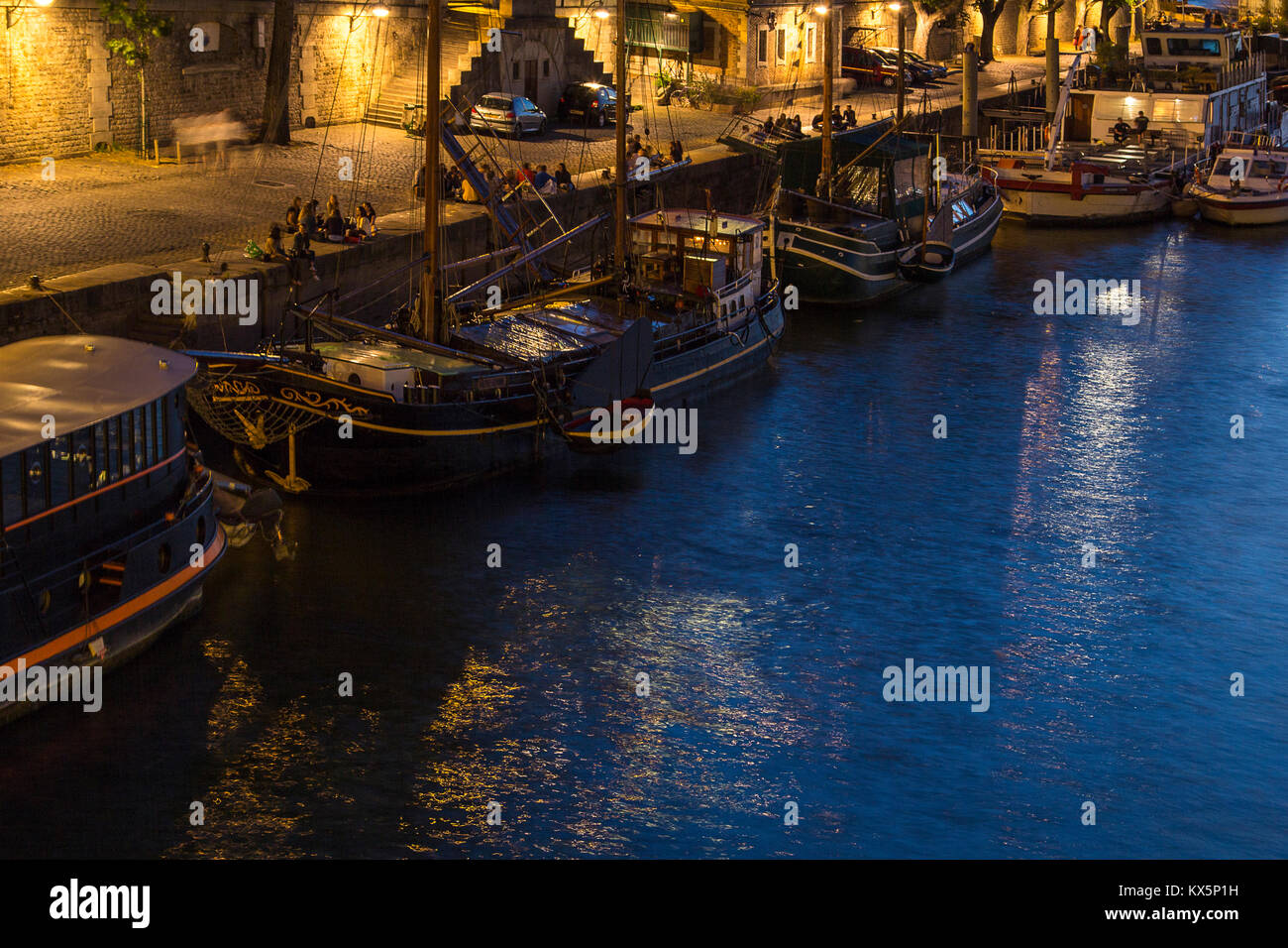 Night falls on Seine river view with boats anchored on quay. River Seine Paris - Stock Image