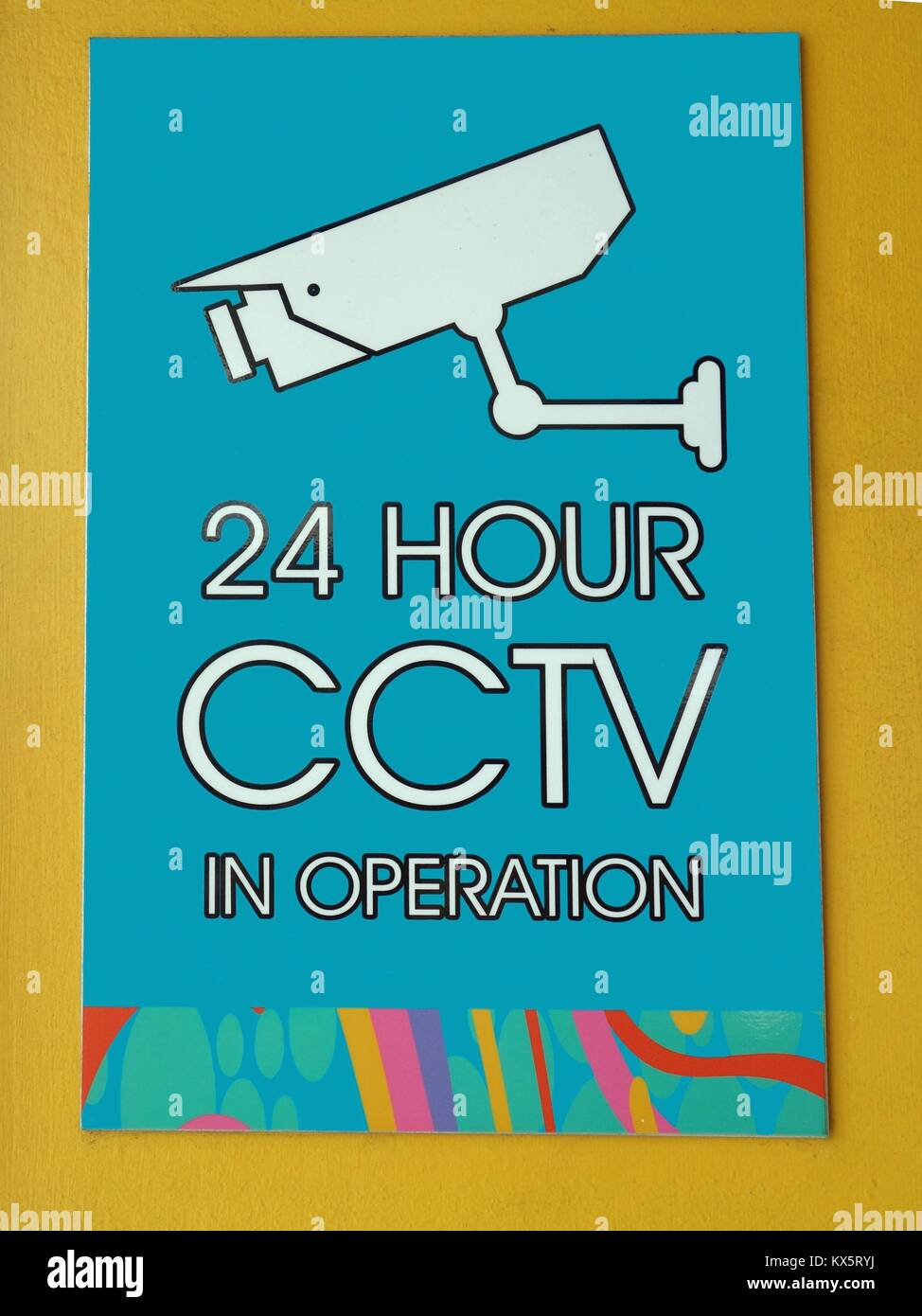 A sign warning that CCTV cameras are in operation 24 hours a day in this location - Stock Image