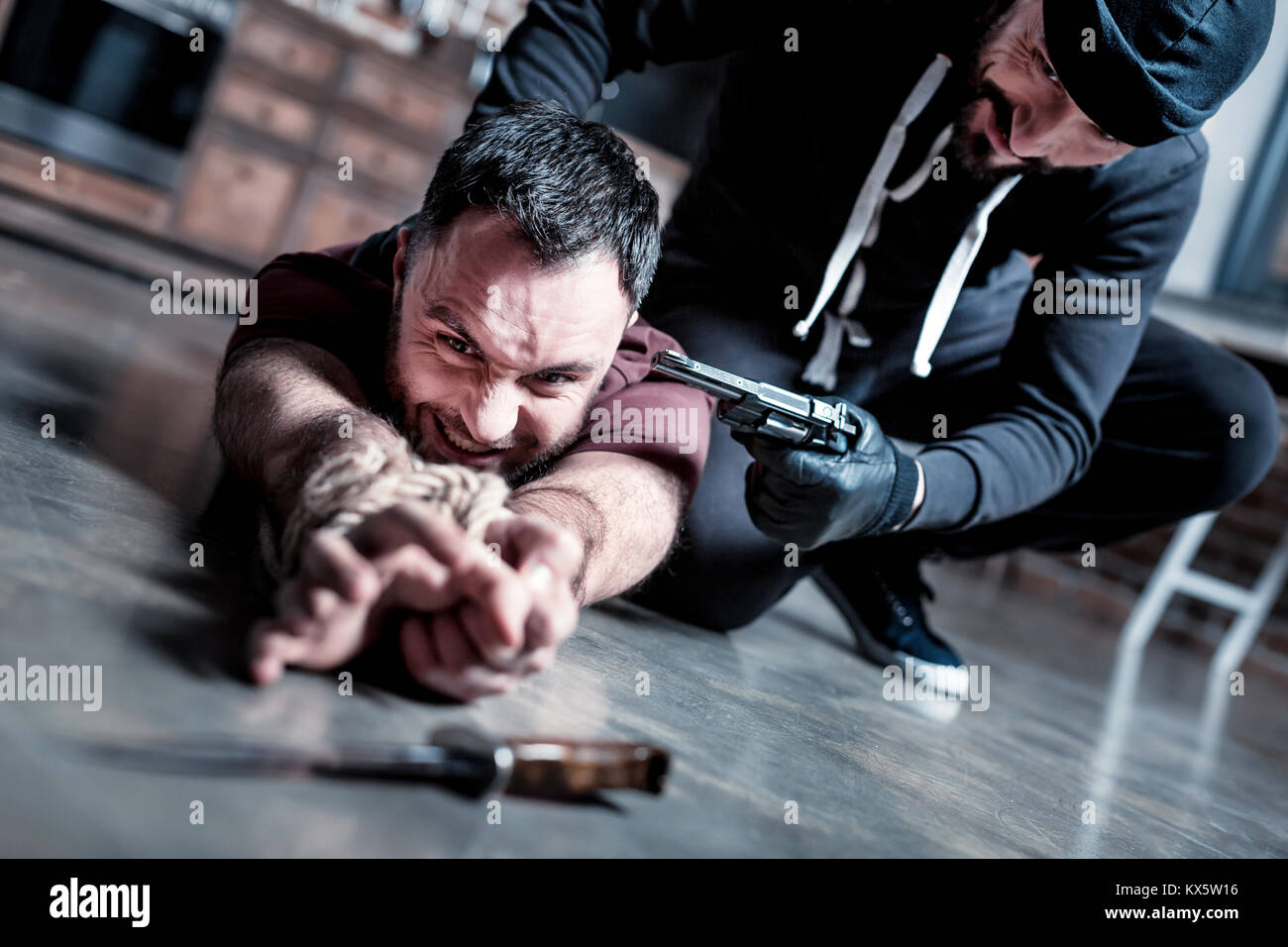 Frightened man trying to escape - Stock Image