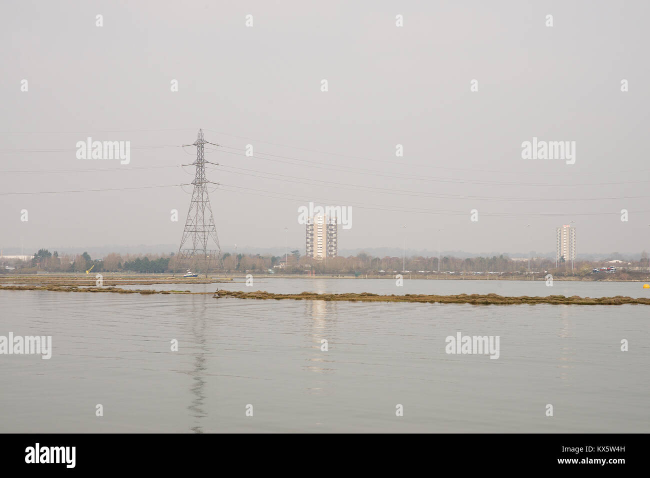 Electrical pylon and hi-rise apartments - Stock Image