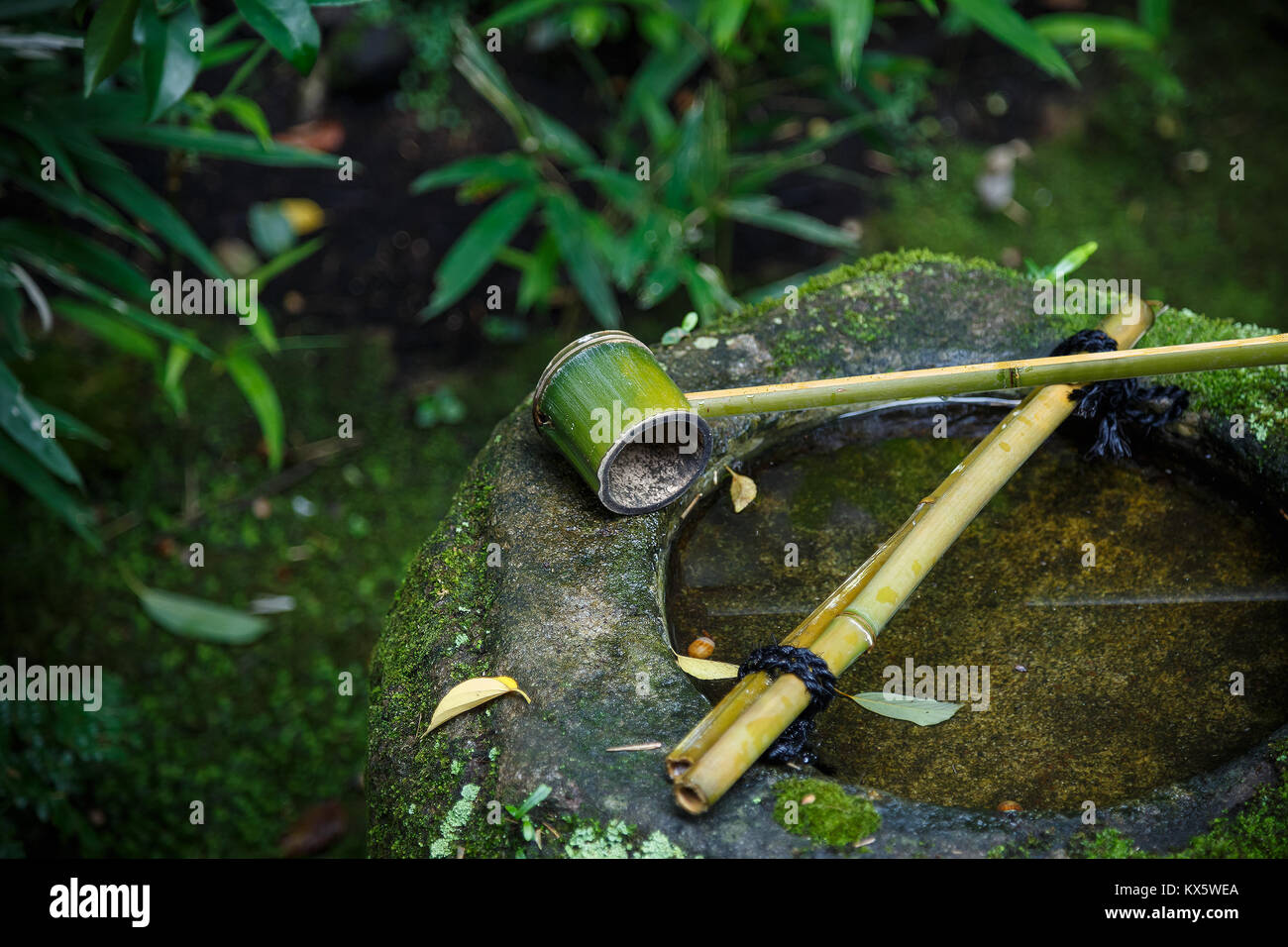 Water dipper on a stone basin at Koto-in Temple in Kyoto, Japan  KYOTO, JAPAN - OCTOBER 22: Koto-in Temple in Kyoto, - Stock Image