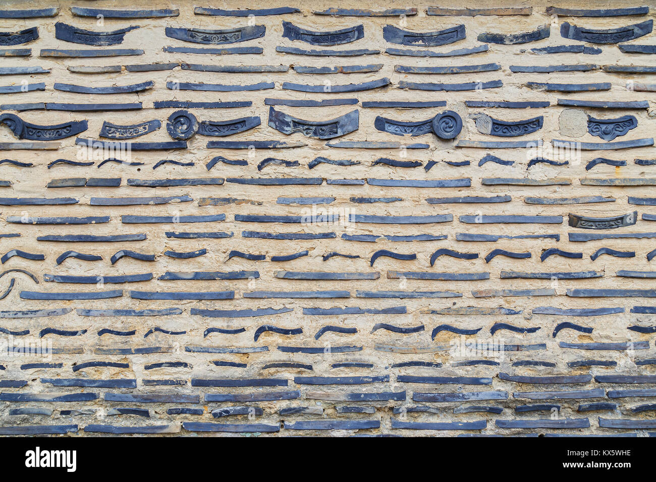 The wall of Daitokuji Temple composed of broken roof tile - Stock Image