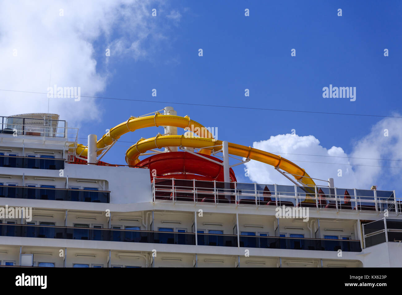 Yellow and Red Slide on a Cruise Ship - Stock Image