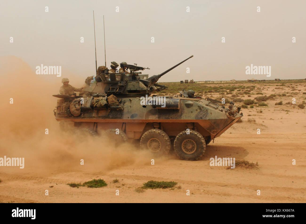 (Pfc. Ariel J. Solomon 20110524-A-JA114-193)  A Marine LAV speeds it's way toward the firing range, kicking - Stock Image