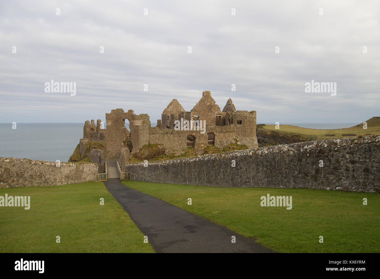 The visitor entrance to ruins of Dunluce Castle on the County Antrim coast. Dunluce Castle is a popular castle to - Stock Image