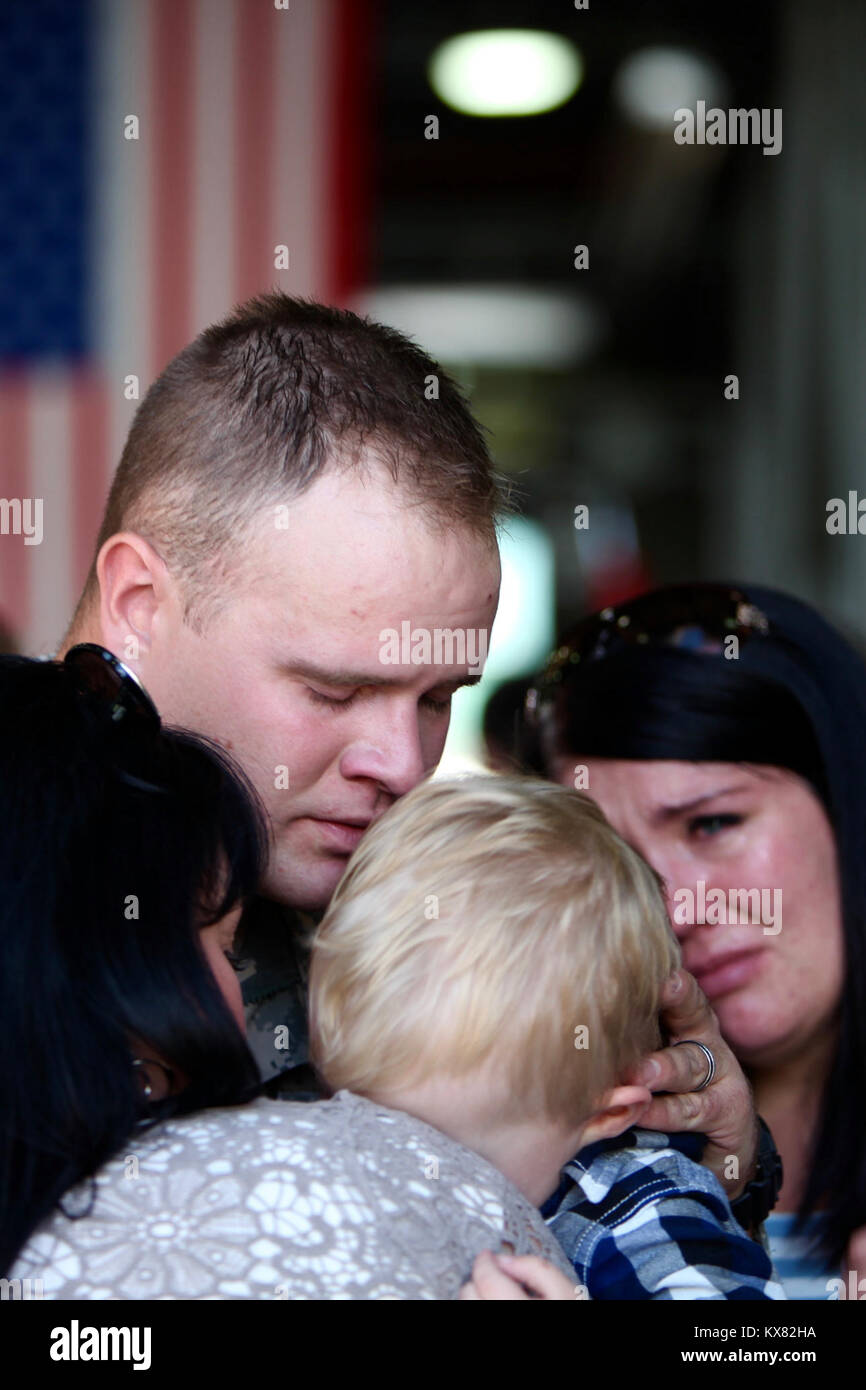 U.S. Army National Guard leaving for deployment with tearful goodbye from family and friends. - Stock Image