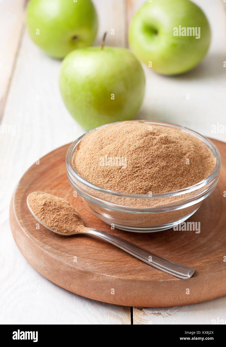crushed apple fiber, green apple on a light  background. dietary product - Stock Image