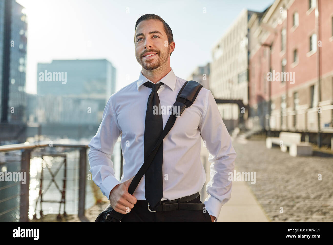 Business man after work going home through the city - Stock Image
