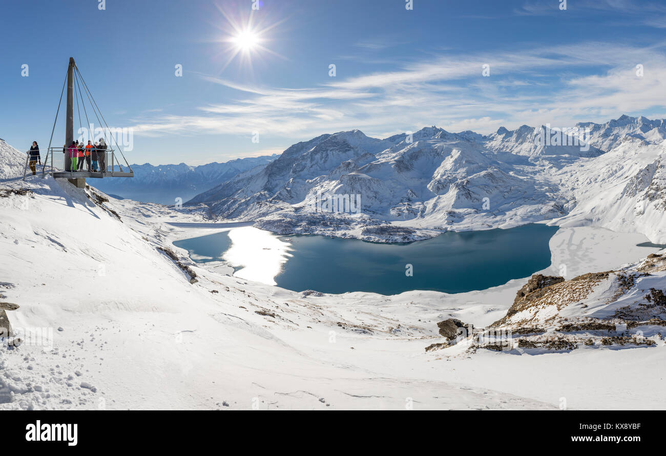 VAL CENIS, FRANCE - DECEMBER 31, 2017 : People enjoying views of Mont Cenis lake and the surrounding mountains from - Stock Image