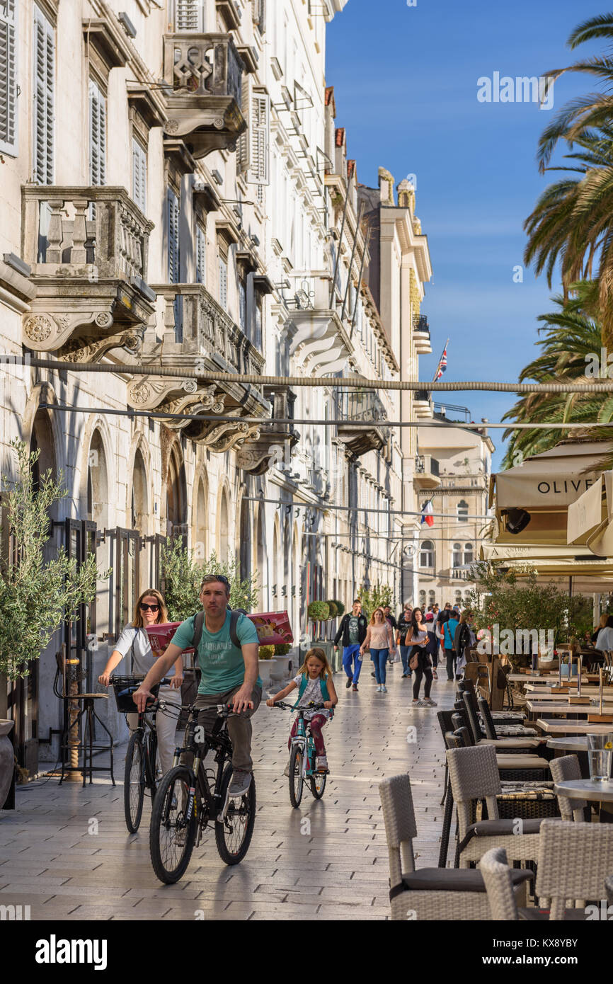 Family bicycling on Riva, Split, Croatia - Stock Image