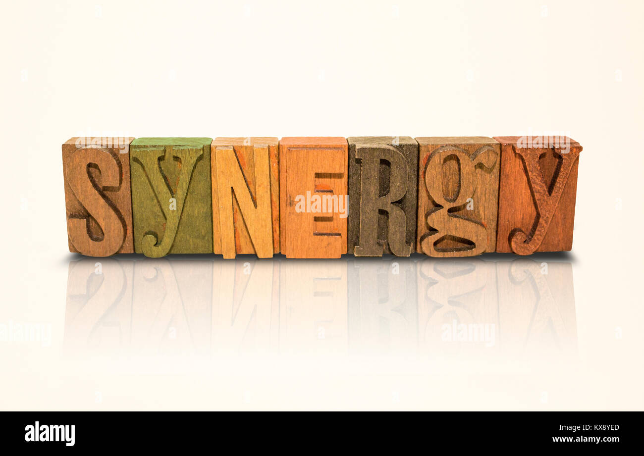 Synergy Word Block Letters on  Isolated White Background - Stock Image