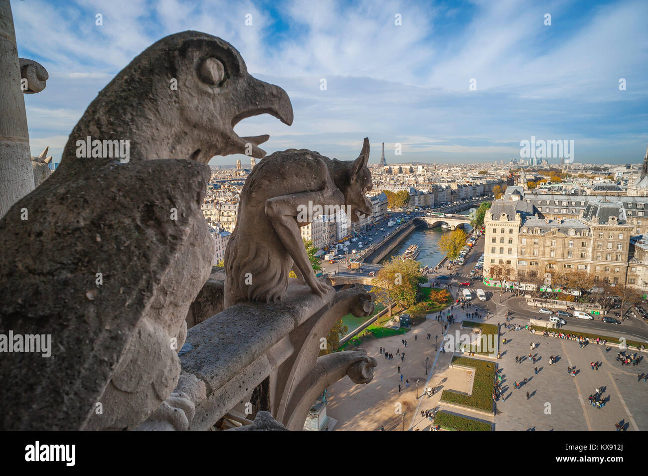 Notre Dame Cathedral, elevated view from the cathedral's West Tower gallery of a gargoyle and an eagle looking down Stock Photo