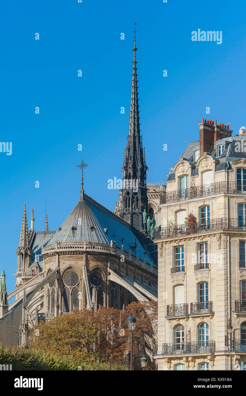 Ile de la Cite Paris, the east end of Notre Dame Cathedral with an elegant 19th century apartment building alongside, - Stock Image
