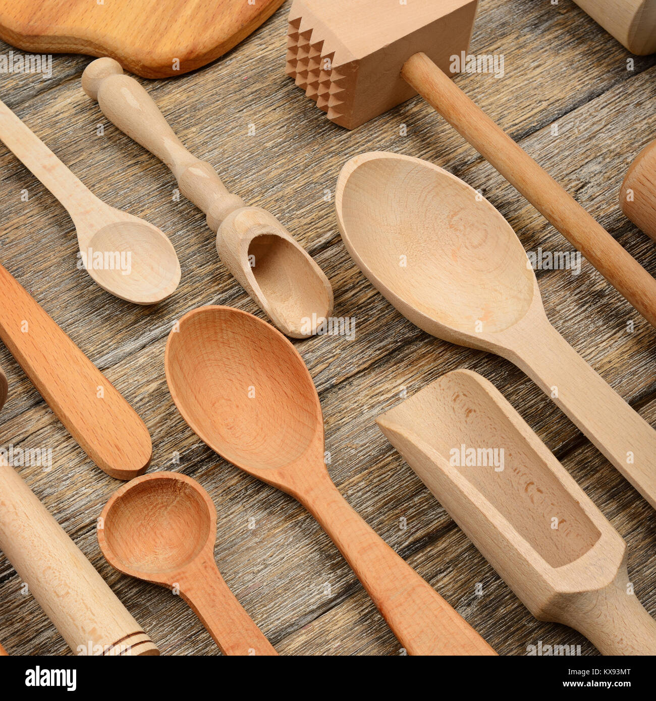 Set kitchen utensils on wooden table. Spoon, fork, rolling pin, hammer kitchen, kitchen spatula. Top view. - Stock Image