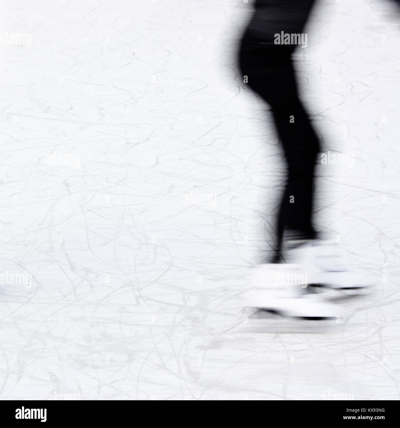 Arty blurry teenage girl ice skating legs , fun and winter recreation detail - Stock Image