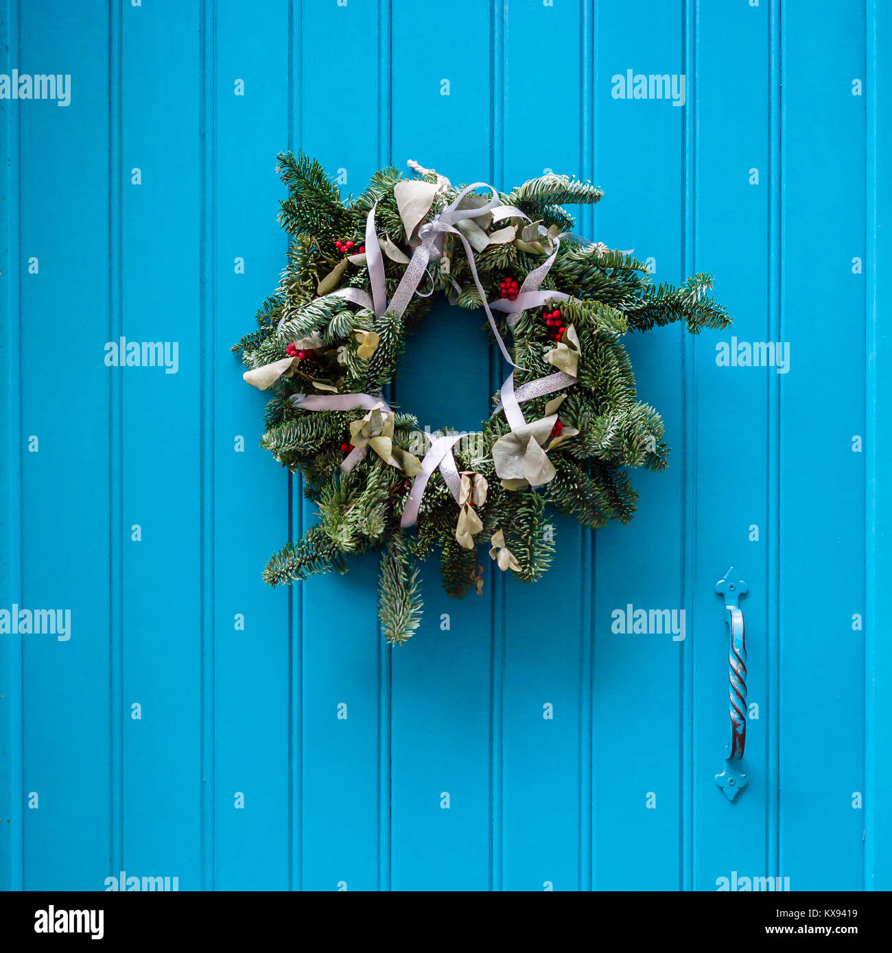 Front View Of A Traditional Christmas Wreath Made Evergreen Branches White Ribbons Holly