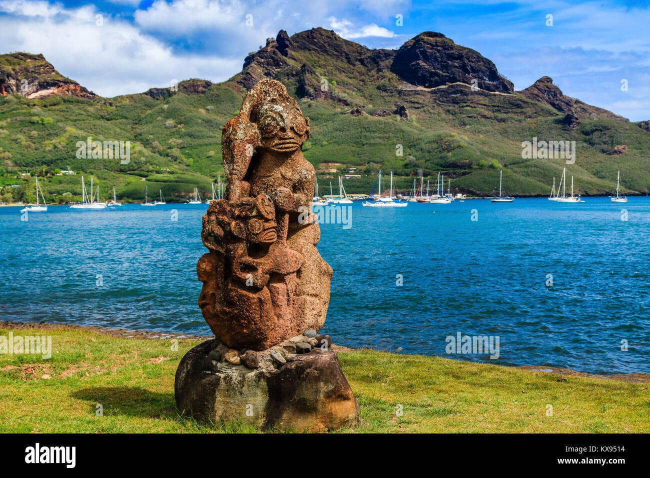 Nuku Hiva, Marquesas Islands. Tiki on the bay of Nuku Hiva. - Stock Image