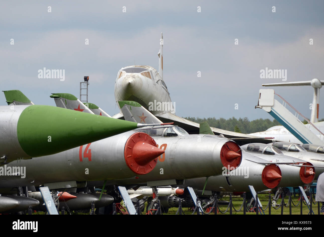 A collection of Sukhoi fighters before the Tupolev Tu-144 on display in Monino museum. - Stock Image