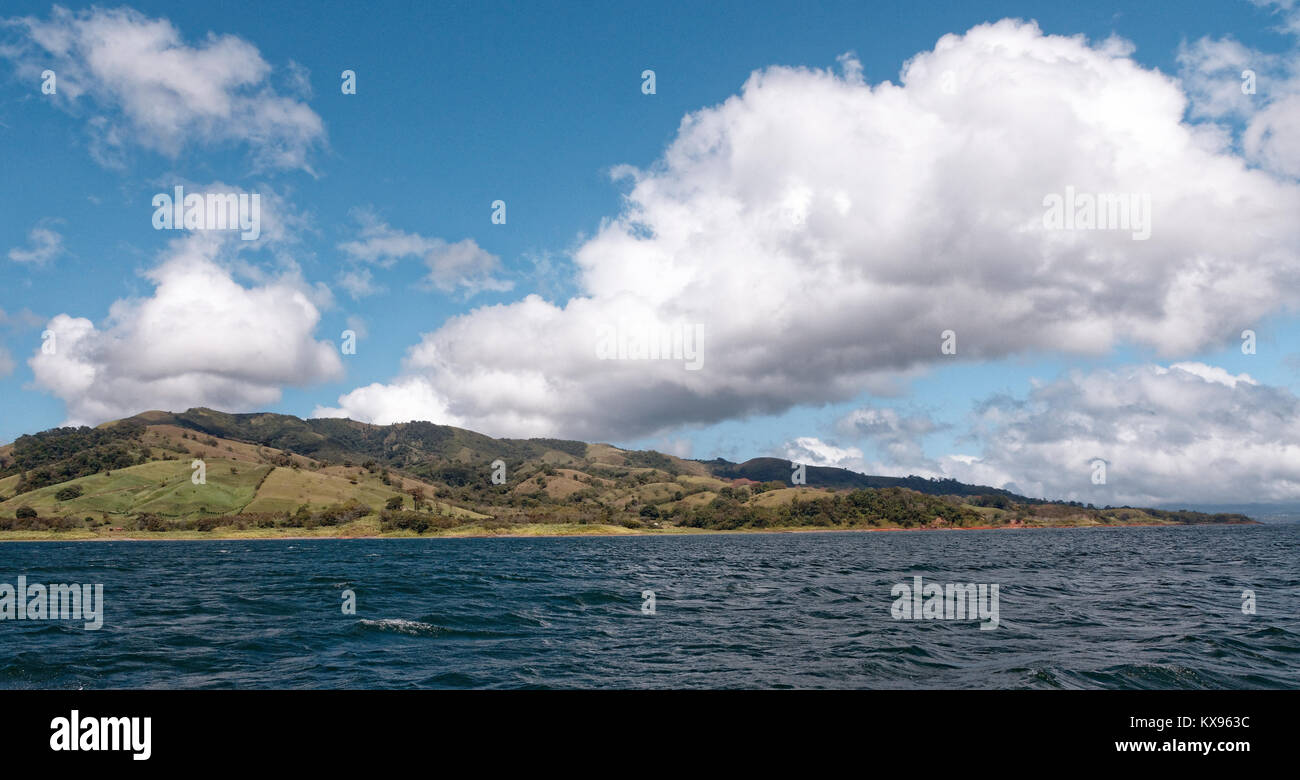 Hillside and clouds over Lake Arenal, Costa Rica - Stock Image