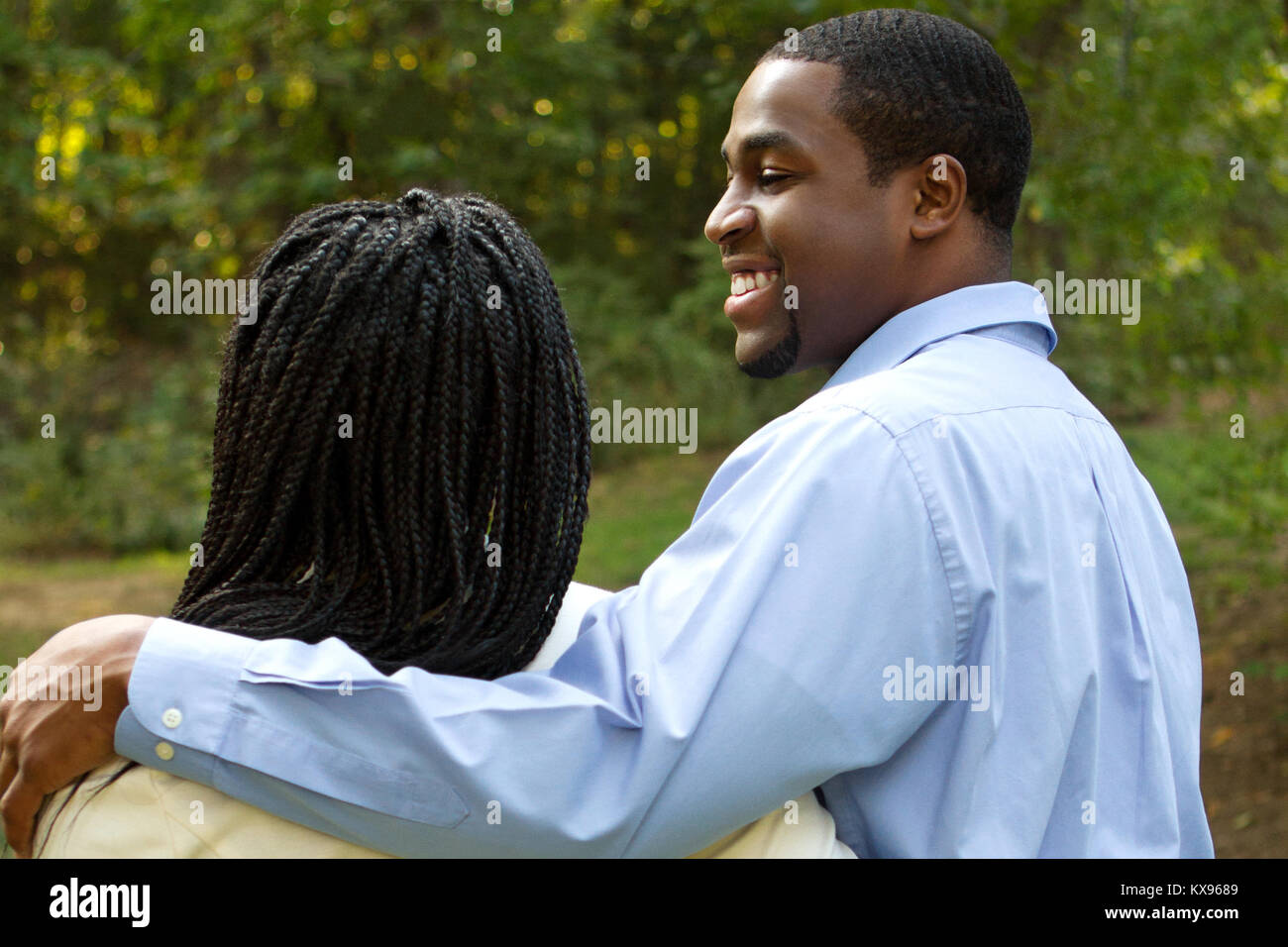 Beautiful happy couple smiling outside. - Stock Image