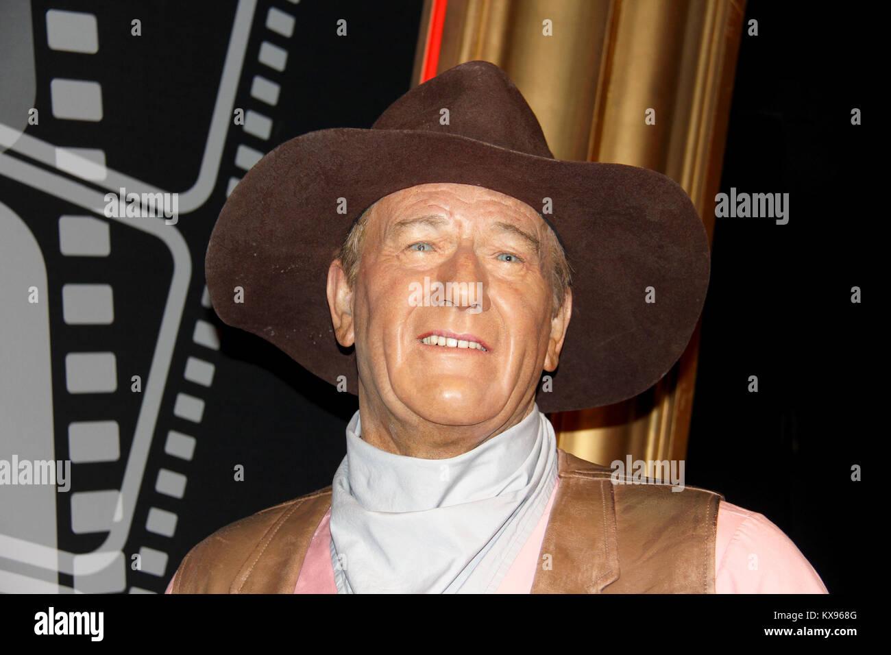 London, - United Kingdom, 08, July 2014. Madame Tussauds in London. Waxwork statue of John Wayne. - Stock Image