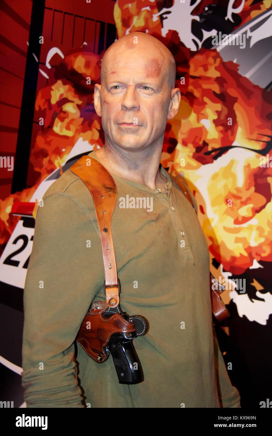 London, - United Kingdom, 08, July 2014. Madame Tussauds in London. Waxwork statue of Bruce Willis. - Stock Image