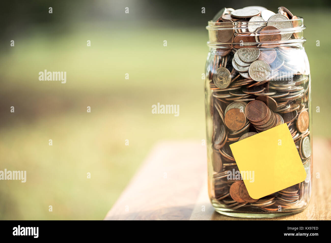 Mony jar outside with copy space. - Stock Image