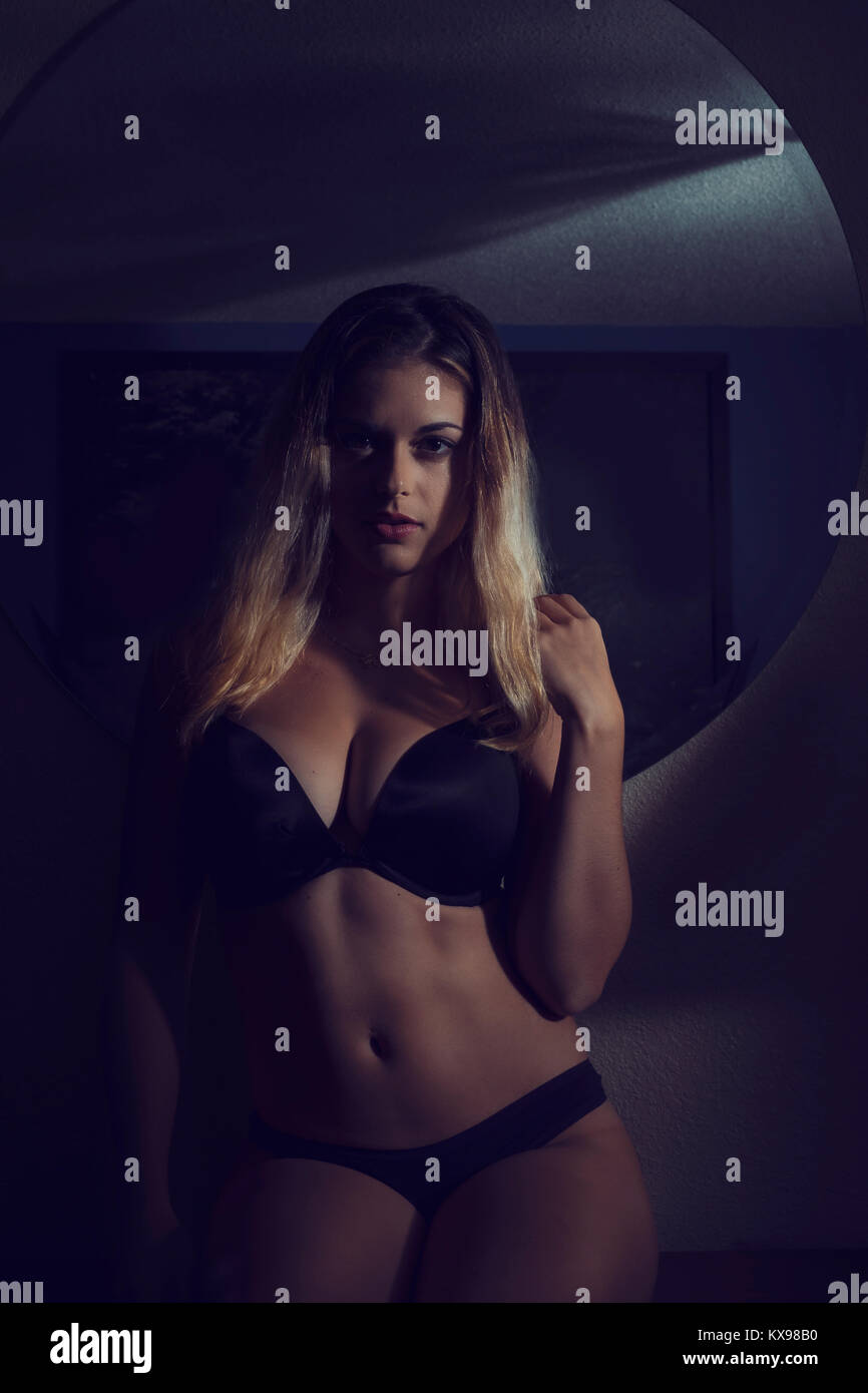 b4d2d49ca Young Woman in Lingerie in Dark Hotel Room Stock Photo  171078516 ...