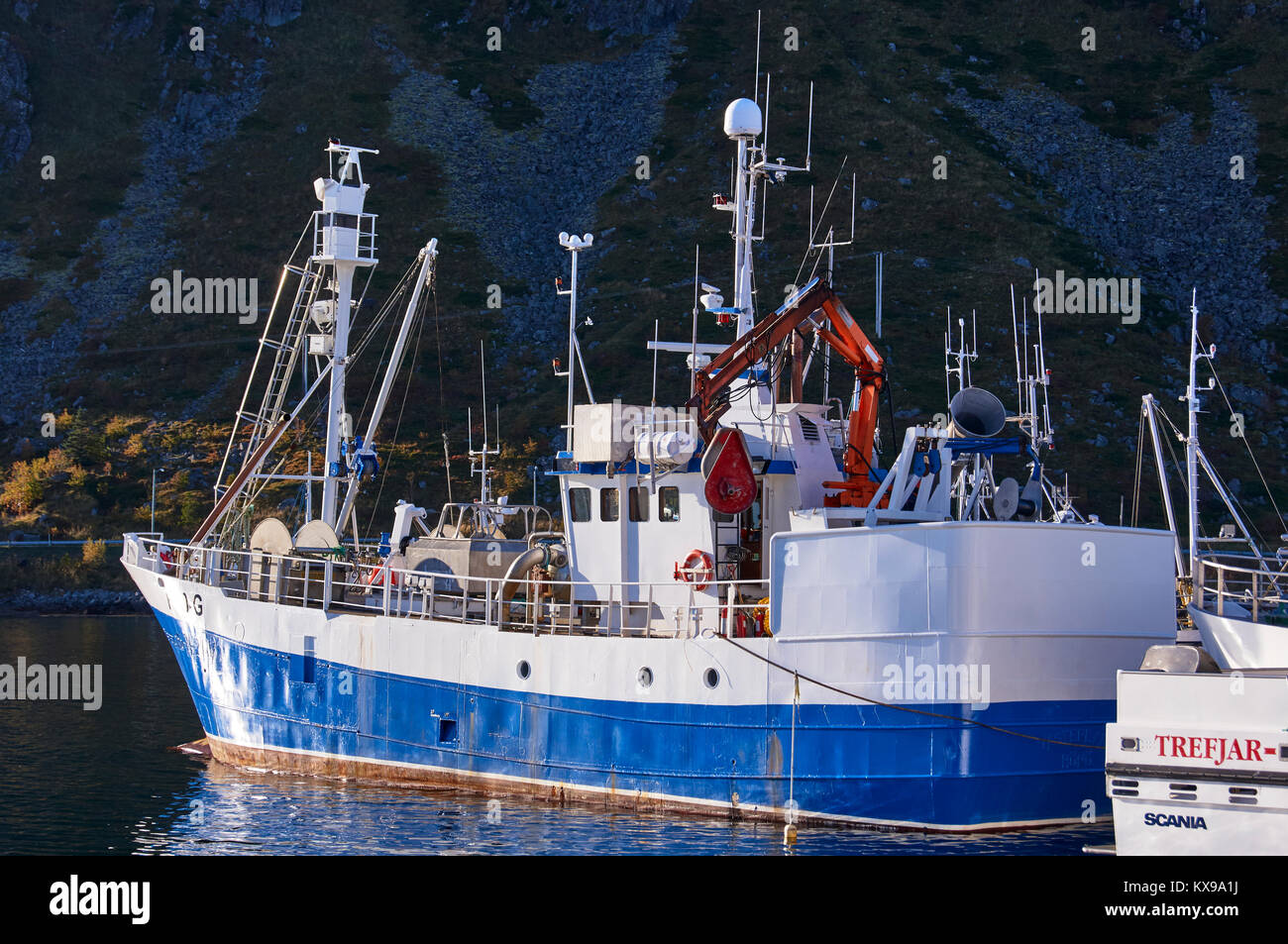 Fishing boat, Ballstad harbour, Vestagoy, Lofoten, Nordland, Norway Stock Photo