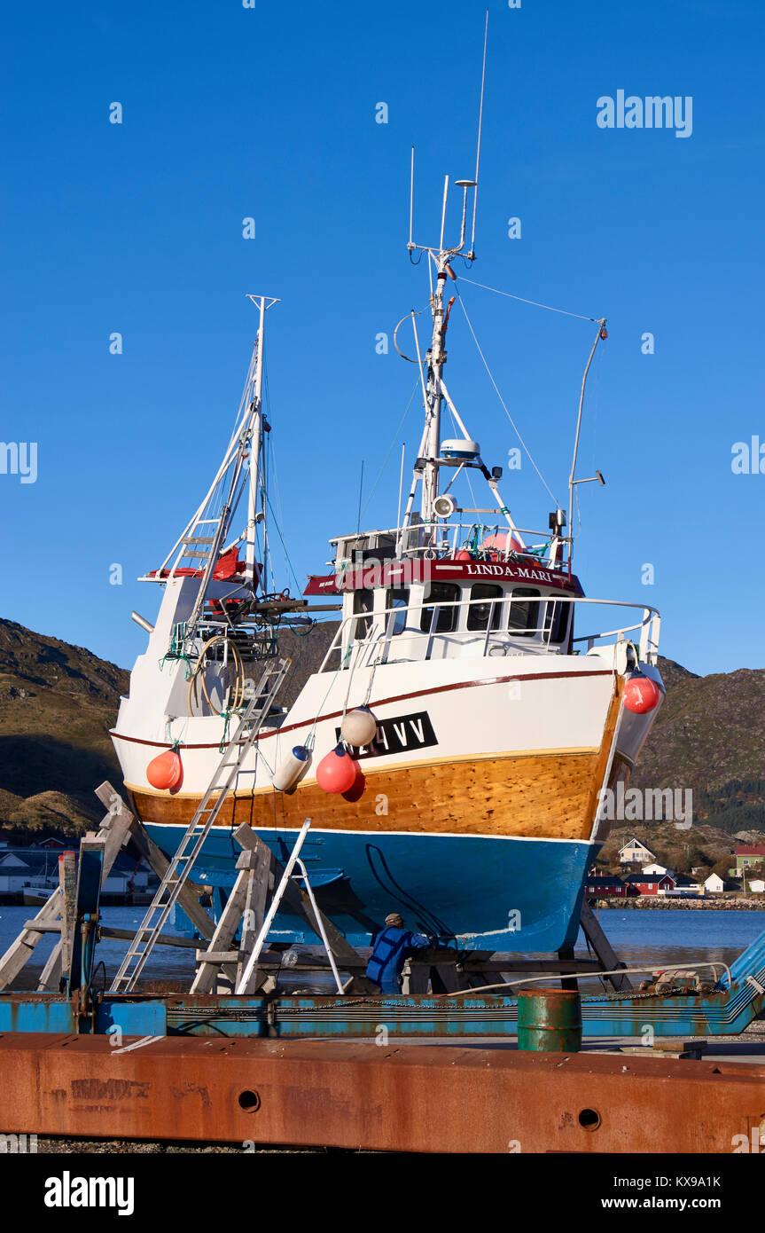 Fishing boat being repaired, Ballstad harbour, Vestagoy, Lofoten, Nordland, Norway - Stock Image