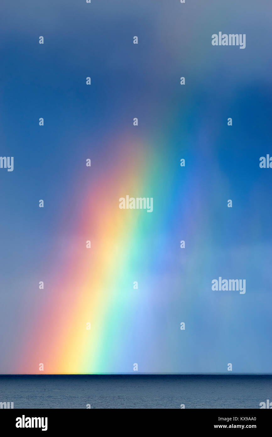Rainbow over the sea.  Viewed from Storvik, Gildeskal, Nordland, Norway - Stock Image