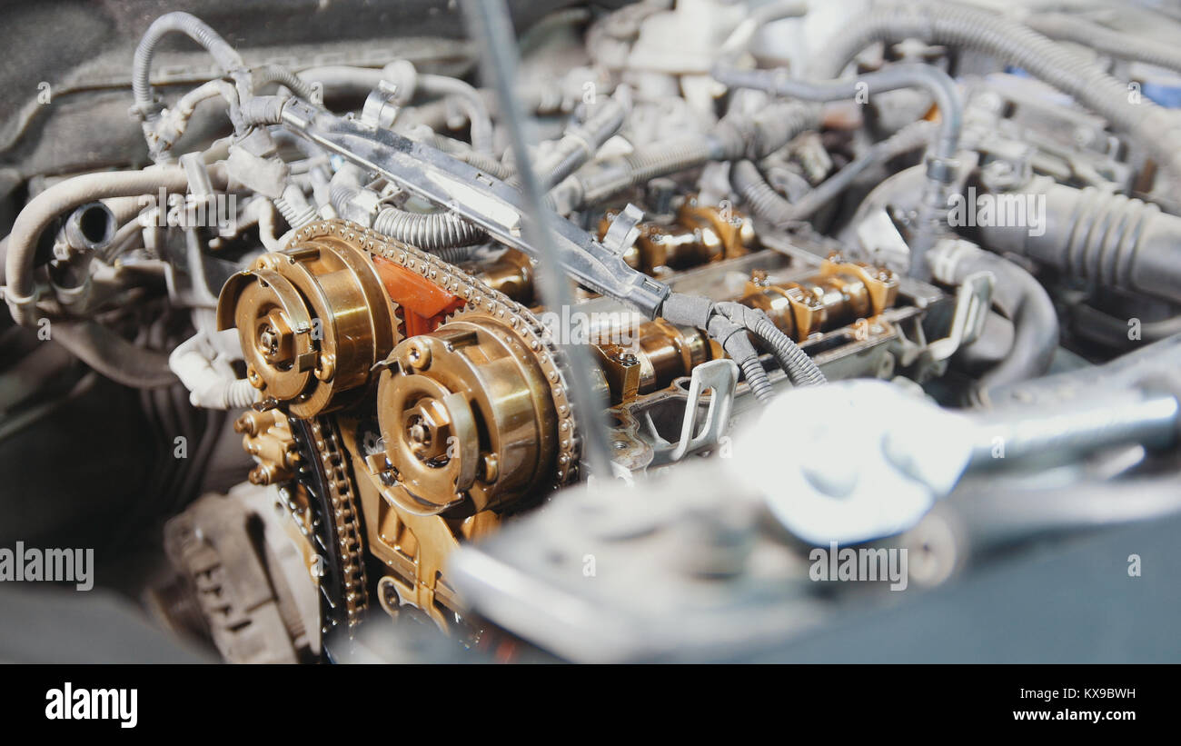 The internal combustion engine, disassembled, repair at car service, overhaul, under the hood of the car - Stock Image