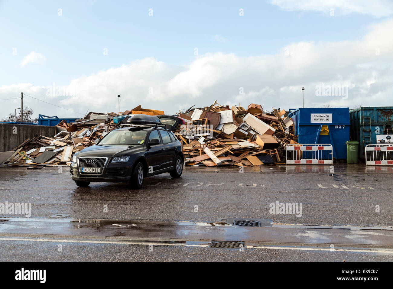 recycling centre,squander, fritter away, misspend, misuse, spend recklessly, throw away, lavish, be wasteful - Stock Image