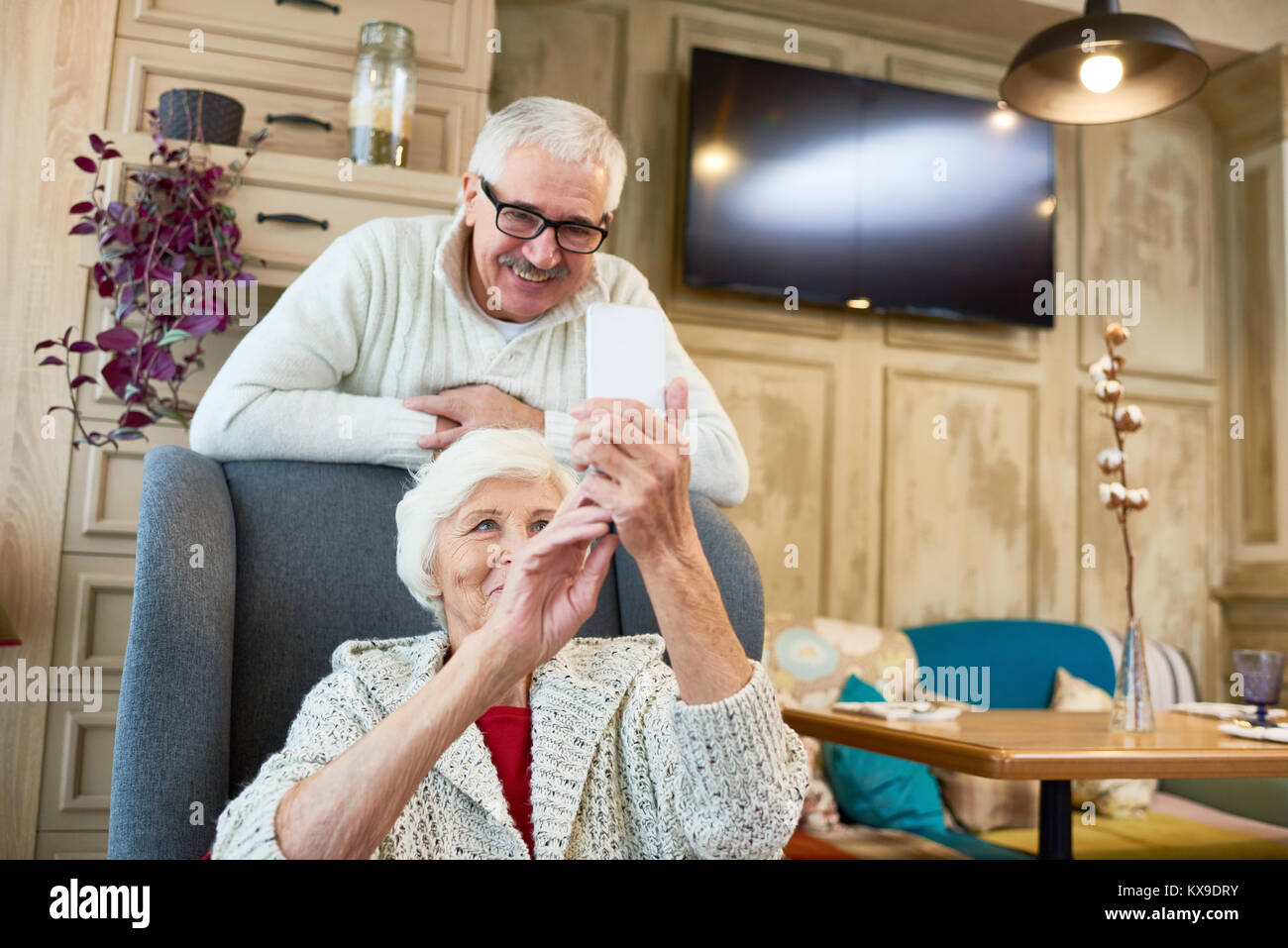 Taking Selfie with Senior Husband - Stock Image